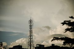 Cellular phone tower in sunset background stock photography
