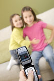 Cellular photography. Two girls on a cellular photography Royalty Free Stock Images