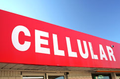 Cellular Sign on Convenience Store Royalty Free Stock Images
