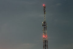Cellular signal transmitter tower at night Royalty Free Stock Images