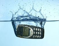 Cellular splashing into water Stock Photo