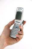 Cellular Telephone in Hand. Cellular telephone in a man's hand royalty free stock photo
