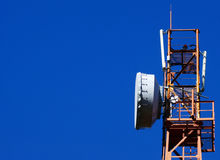 Cellular tower. Cellular communications tower on a clear day the blue sky Stock Photos
