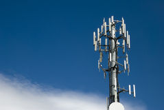 Cellular tower. And a partly sunny sky Royalty Free Stock Photos