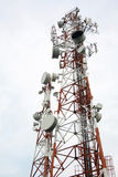 Cellular tower. Two cellular communication towers on a cloudy day Stock Photo