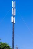 Cellular tower against a blue sky Stock Photos
