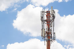 Cellular tower against a cloudy sky Royalty Free Stock Images