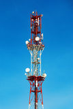 Cellular tower with antenna in red and white Royalty Free Stock Photography