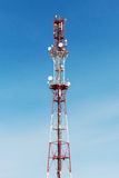 Cellular tower with antenna in red and white Stock Image