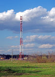 Cellular tower on a background of spring landscape Royalty Free Stock Photos