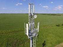 Cellular tower. Equipment for relaying cellular and mobile signal Royalty Free Stock Photo