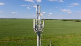 Cellular tower. Equipment for relaying cellular and mobile signal. Fly around up and down Royalty Free Stock Image