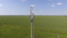 Cellular tower. Equipment for relaying cellular and mobile signal. Fly around up and down Royalty Free Stock Images