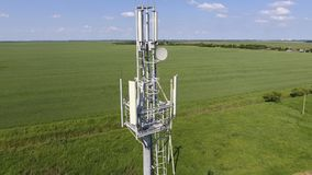 Cellular tower. Equipment for relaying cellular and mobile signal. Fly around up and down Stock Photo