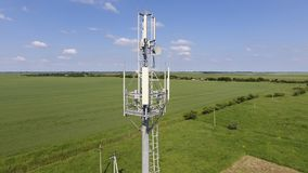 Cellular tower. Equipment for relaying cellular and mobile signal. Fly around up and down Stock Image
