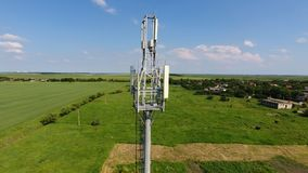 Cellular tower. Equipment for relaying cellular and mobile signal. Fly around up and down Royalty Free Stock Photography