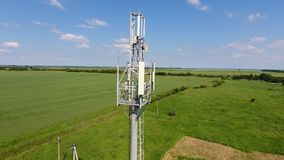 Cellular tower. Equipment for relaying cellular and mobile signal. Fly around up and down Stock Images