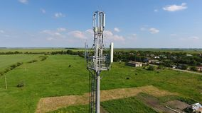Cellular tower. Equipment for relaying cellular and mobile signal. Fly around up and down Stock Photos