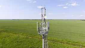 Cellular tower. Equipment for relaying cellular and mobile signal. Fly around up and down Stock Photography