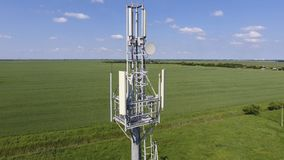 Cellular tower. Equipment for relaying cellular and mobile signal. Fly around up and down Royalty Free Stock Photos