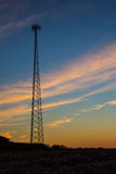 Cellular tower silhouette at sunset Royalty Free Stock Photos