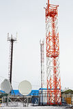 Cellular towers in northern village. In Arctic royalty free stock photos