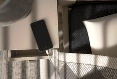 Cellulare accanto al letto Fotografia Stock Libera da Diritti