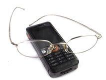 Cellulare con gli occhiali Immagini Stock