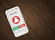 Cellulare con la chiamata in arrivo Fotografia Stock Libera da Diritti