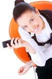 Cellulare della holding della donna di affari Fotografie Stock