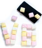 Cellulare e caramella gommosa e molle con sei numeri zero Fotografia Stock Libera da Diritti