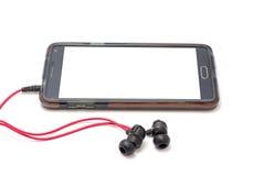 Cellulare e cuffia Fotografia Stock