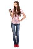 Cellulare piacevole della holding dell'allievo in sua mano Fotografie Stock