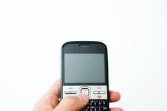 Cellulare in una mano Fotografia Stock Libera da Diritti