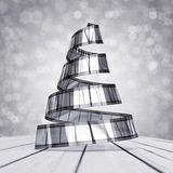 Celluloid christmas tree. Celluloid silver christmas tree on white-grey background Stock Photo