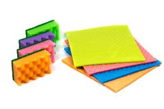Cellulose sponge cloth and an organized stack of cleaning sponges, isolated on the white background. Cellulose sponge cloth and a stack of cleaning sponges royalty free stock photo