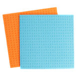 Cellulose sponge clothes. Two cellulose sponges isolated on white background royalty free stock photo