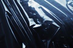 Celofán negro brillante de la textura Foto de archivo libre de regalías