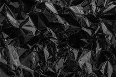 Celofane ou plástico deformado preto Conceito do problema ambiental fotos de stock royalty free
