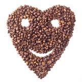 Celowniczy 'serce' z twarzą od Kawowych fasoli Obrazy Royalty Free