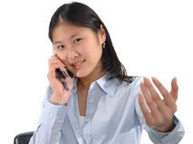 CelPhone Girl. Young Asian girl talking on her cellphone stock image