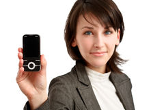 Celphone in hand Stock Photos