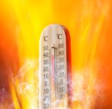 Celsius thermomether with fire flames Stock Images