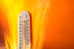 Celsius thermomether with fire flames Royalty Free Stock Images