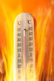 Celsius thermomether with fire flames Royalty Free Stock Photo