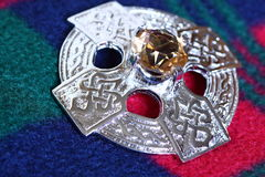 Celtic brooch on tartan B Stock Photography