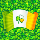 Celtic clover on Irish flag at green clovers Royalty Free Stock Photography