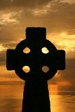 Celtic Cross. Silhouetted against a sunset sky royalty free stock photo