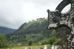 Celtic Cross. And cemetery in glendalough, Ireland stock images