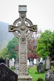 Celtic cross in a cementery at Glendalough Ireland stock images